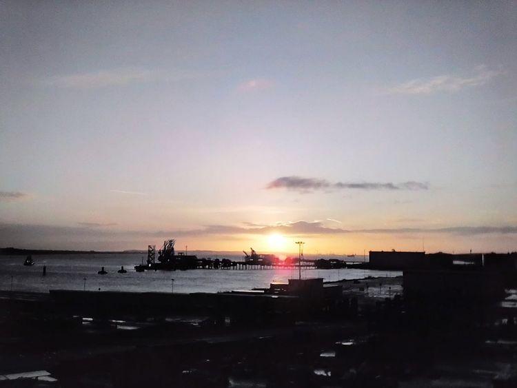 EyeEmNewHere Sunrise Water Shipyardlife Shipyard Sky Sunset Sea Beach Silhouette Horizon Over Water Water Sky Outdoors No People Sun