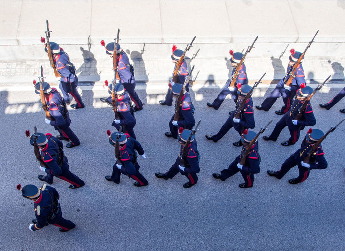 High Angle View Of Army Soldiers Marching On Street