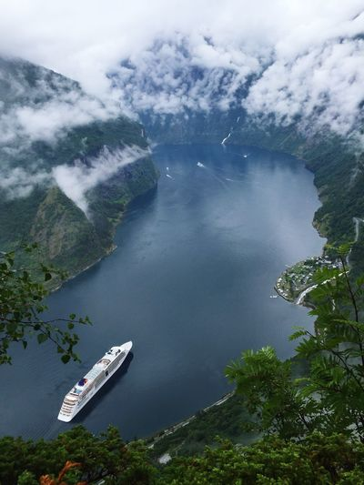 Aerial view of ship on river amidst mountains