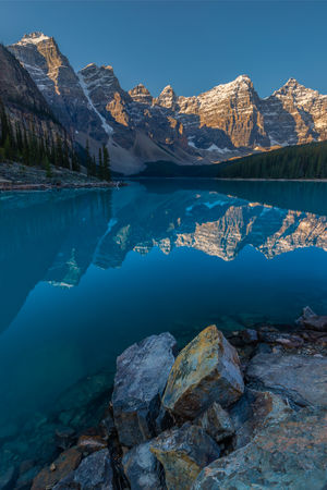 It was snowing when I got up this morning, and is forecast to hit -5 C (23F) tonight. So it seems that summer, despite officially having a week to go, is over. I have been lucky enough to get some extended adventures in over the summer including Maligne Lake, Lake O'Hara, Gimli Ridge, Iceline Trail, Tonquin Valley, and Mt Assiniboine. So the backlog of photos to edit gets longer; but that's a nice problem to have. I am looking forward now to some spectacular autumn colours followed by the sublime quiet and solitude that comes with winter in the North. Between hiking the Tonquin Valley loop and travelling down to Mt Assiniboine we managed to finally stop in for sunrise at Moraine Lake and the Valley of the Ten Peaks. Those that know me know how much I like crowded places, but this is one spot where the crowds are actually worth it. Moraine Lake sits at an elevation of 1,885 m (6,183 ft) in Banff National Park. The iconic colour of the lake is due to light scattering from fine particles of glacial rock flour. Love Life, Love Photography Alberta, Canada Banff National Park  Banff, Alberta Moraine Lake  Blue Day Formation Idyllic Lake Mountain Mountain Range Nature No People Non-urban Scene Outdoors Reflection Rock Rock - Object Scenics - Nature Sky Snowcapped Mountain Tranquil Scene Tranquility Turquoise Colored Water