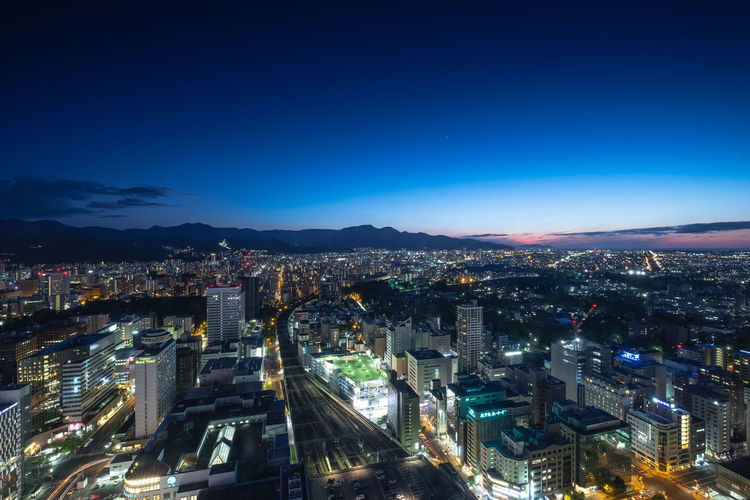 Hokkaido Architecture Blue Building Building Exterior Built Structure City City Life Cityscape Copy Space Crowd Crowded Glowing High Angle View Illuminated Modern Nature Night Office Building Exterior Outdoors Residential District Sapporo Settlement Sky Skyscraper