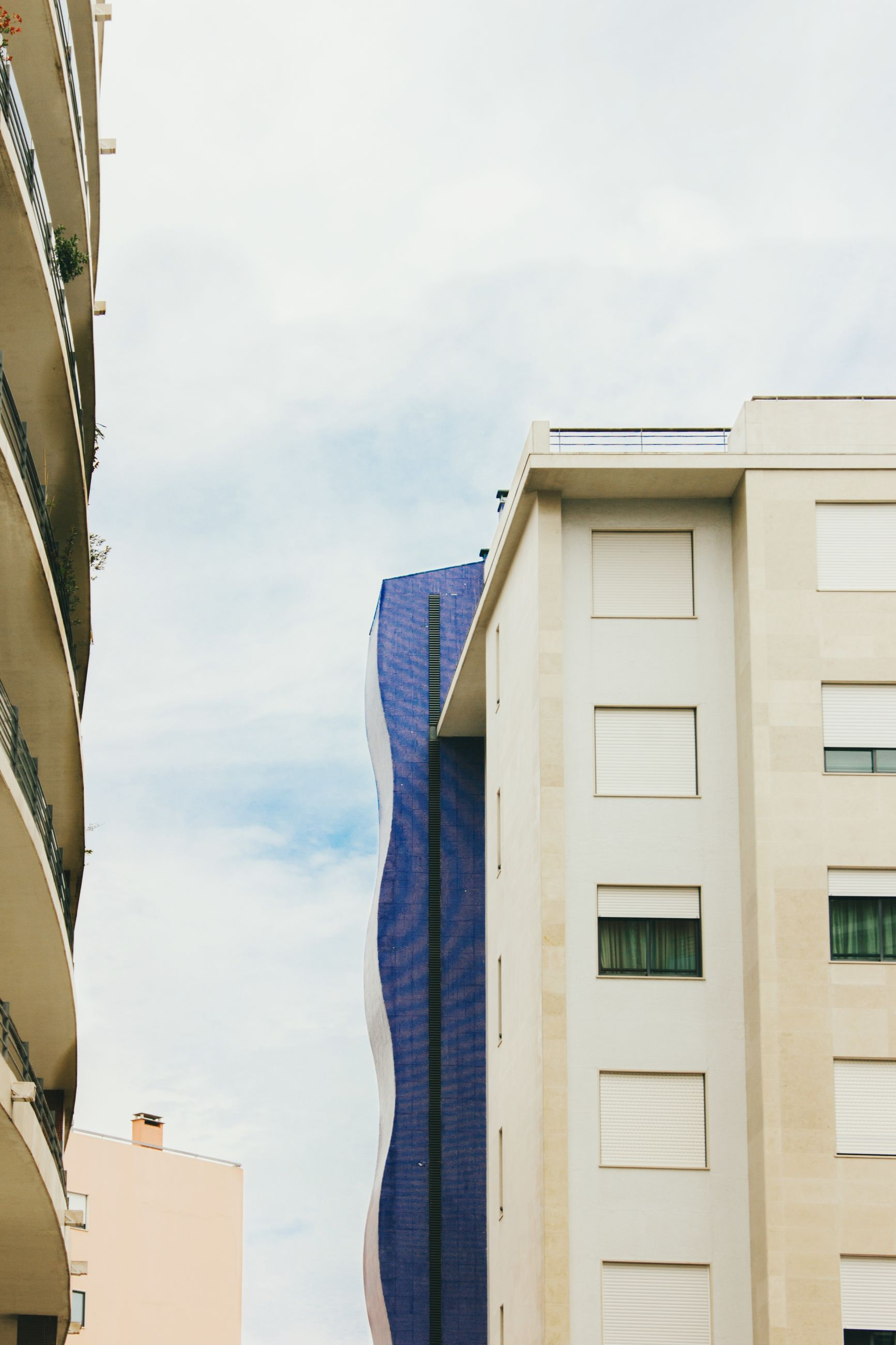 built structure, building exterior, architecture, building, sky, day, cloud - sky, city, window, no people, nature, low angle view, outdoors, residential district, balcony, business, modern, glass - material, technology, apartment