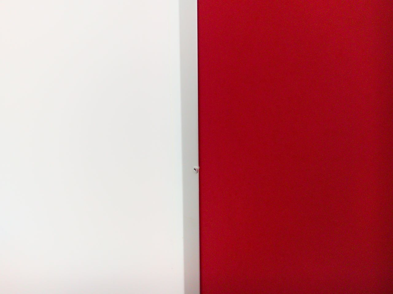 FULL FRAME SHOT OF WHITE WALL AND RED DOOR