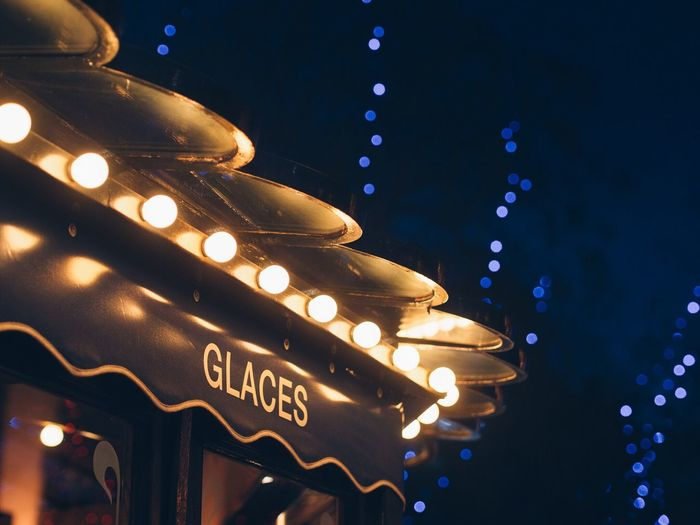 Low Angle View Of Illuminated Ice Cream Parlor At Night