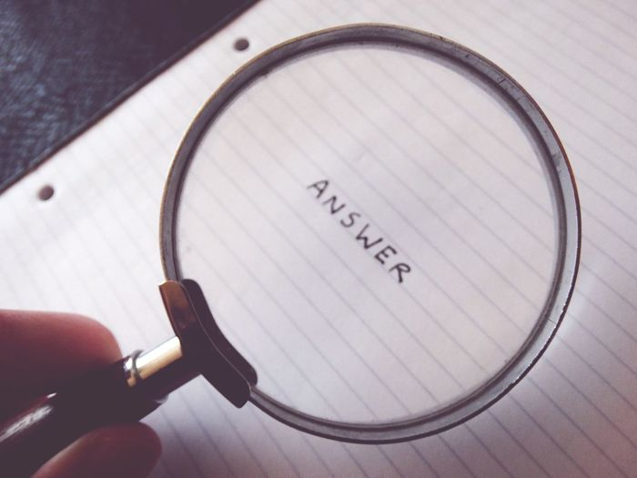Finding the answer 😊 Text Western Script Communication Close-up Indoors  Human Body Part Human Hand Eyeglasses  Day Magnifying Glass Magnified Word Answer Find Searching Search Finding The Answer Problem Solving Glass Holding NotePad Notebook