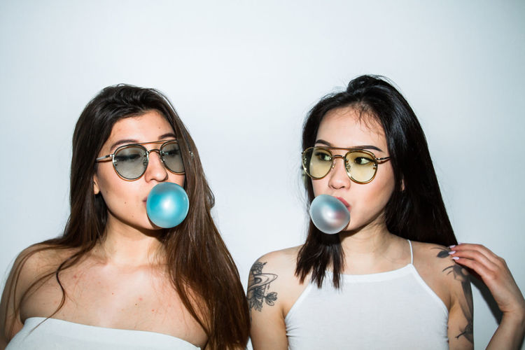 Adult Bubble Bubblegum Canon Canon7d  Canonphotography Close-up Eyeglasses  Gum Looking At Camera Model People Portrait Sunglasses Toronto Two People White White Background Young Adult