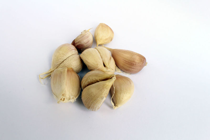 High angle view of garlic against white background