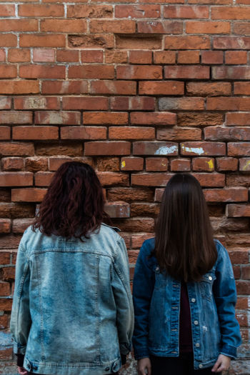 Blue Two People Brick Wall Rear View Women Lifestyles Togetherness Real People Day Outdoors EyeEmNewHere
