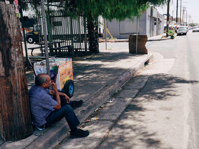 Takin a break Street Vendor Sitting Outdoors Adult People Day Full Length California Dreamin City