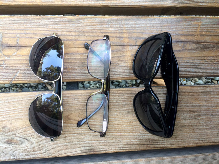 Absence Choice Close-up Day Directly Above Eating Utensil Eyeglasses  Fashion Glasses Group Of Objects High Angle View Indoors  Kitchen Utensil No People Personal Accessory Spoon Still Life Sunglasses Table Wood - Material