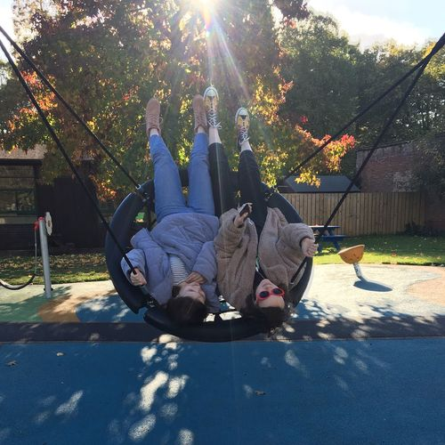 Friendship Friends Girls Playground Teens Teenagers  Swing Sunlight Tree Nature Plant Day Real People Park