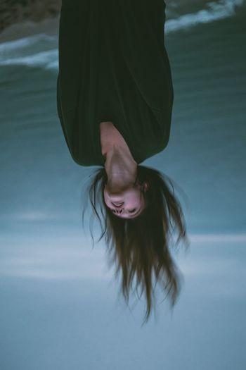 Low section of young woman in water