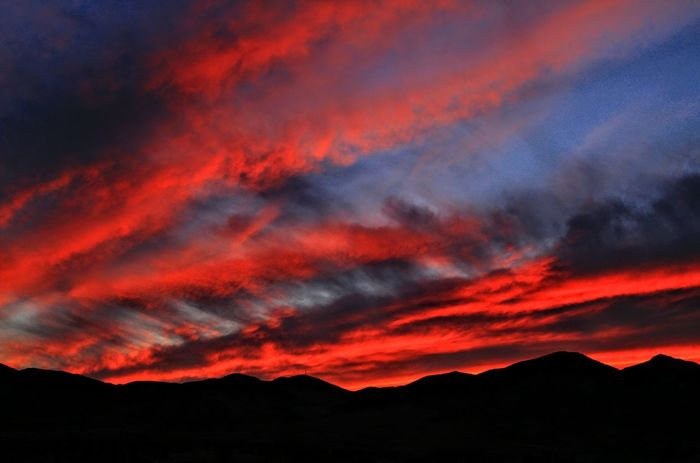 Sunset over the Oquirrh Mountains, West Jordan, Utah...10/04/2017. Dramatic Sky Sunset Nature No People Outdoors Mountain Red Cloud - Sky Lava Power In Nature Beauty In Nature Sky Landscape Scenics Night Silhouette Weather Orange Color Dramatic Sky Beauty In Nature