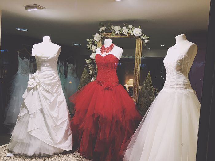 Low angle view of wedding dresses at fashion store