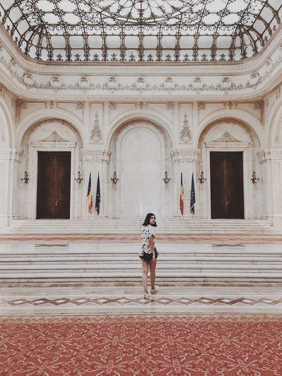 Full length portrait of woman walking in palace