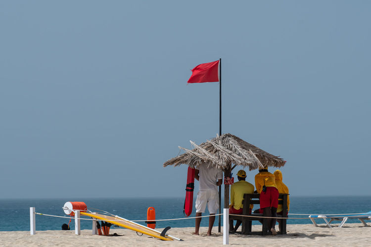 Hoffi99 Life Guard Life Guard Stand Life Guards Beach Nature Sky Day Outdoors Water Sea Horizon Over Water Red Clear Sky Real People Protection Beauty In Nature Security Flag Umbrella Horizon Scenics - Nature Copy Space Men