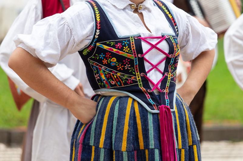 Midsection of woman wearing traditional clothing while standing outdoors