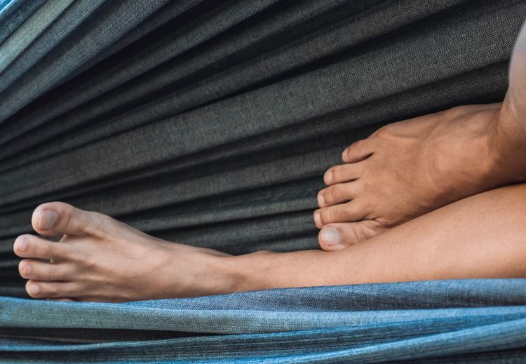 Resting Vacations Feet Fabric Hammock Relaxing Human Body Part Human Hand Hand Body Part Real People Women Lifestyles People Human Leg
