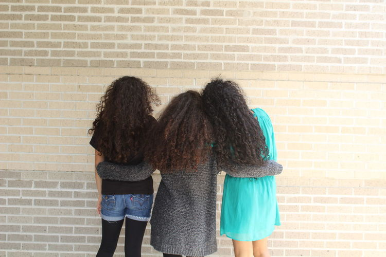 Adult Bonding Brick Wall Day Friendship LasTresChi Outdoors People Rear View Standing Three Quarter Length Threemusketeers Togetherness Two People