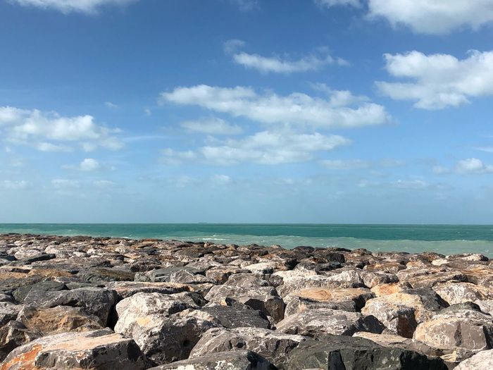 Sky Sea Water Cloud - Sky Scenics - Nature Horizon Horizon Over Water Tranquil Scene Beach Nature Day Rock Beauty In Nature Tranquility Solid No People Land Idyllic Outdoors Sunlight
