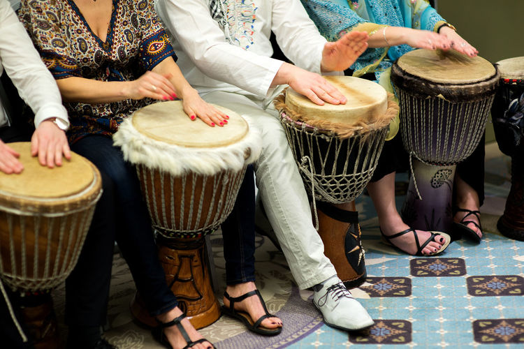 Low Section Of People Playing Drum At Home