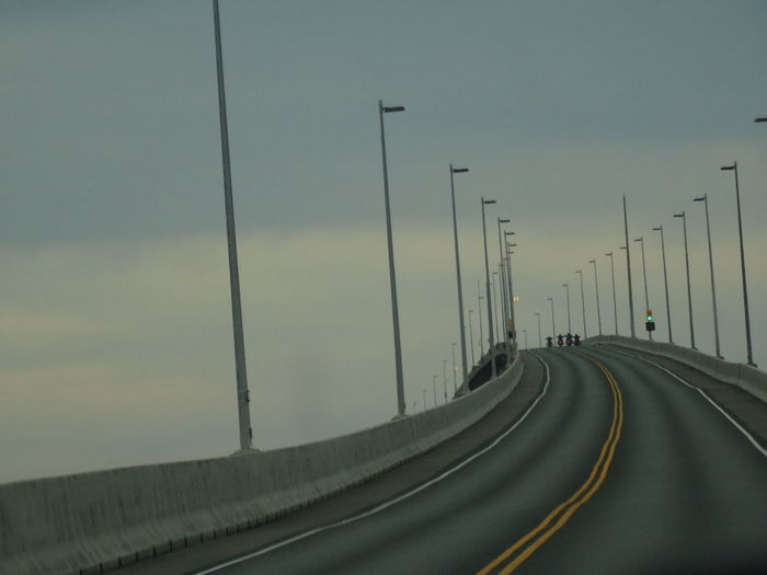 Driving on the Confederation Bridge, the 12,9 km bridge between New Brunswick and Prince Edward Island! Confederation Bridge Travel Cloud - Sky Connection Diminishing Perspective Direction Dividing Line Highway Marking Mode Of Transportation Motion Multiple Lane Highway Nature No People Outdoors Prince Edward Island Road Road Marking Sign Sky Street Street Light Symbol The Way Forward Transportation