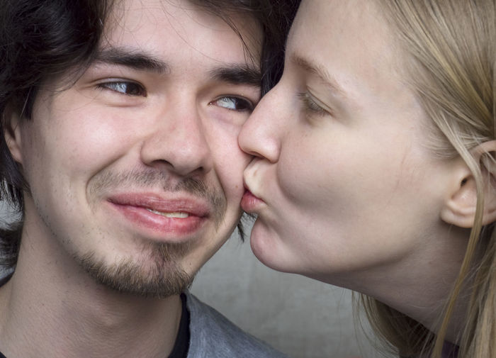 Portrait Headshot Young Adult Two People Close-up Young Men Young Women Togetherness Men Emotion Couple - Relationship Bonding Real People Love Young Couple Looking At Camera Smiling Front View Lifestyles Positive Emotion Body Part Hair Human Face Hairstyle