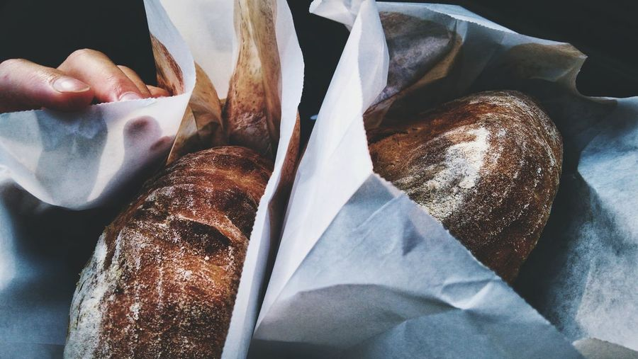 High angle view of fresh bread on paper