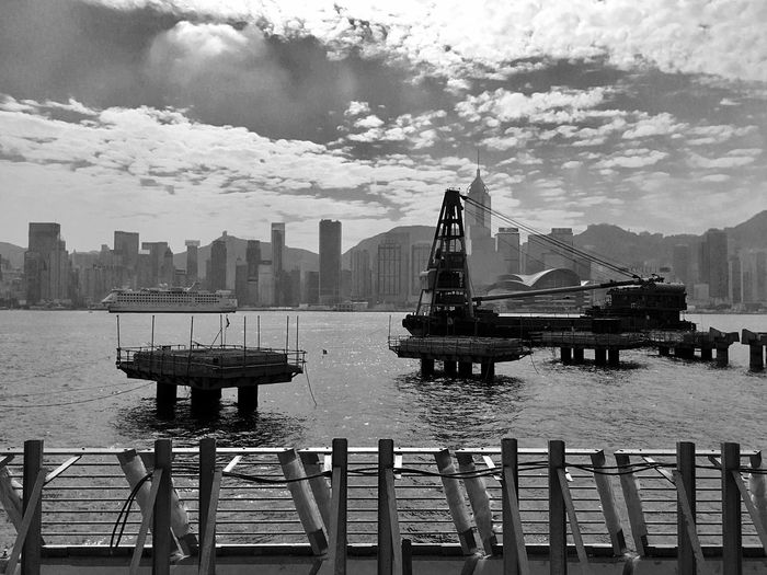 City Barge Built Structure Sunlight And Shadow Layering Light And Shadow IPhoneography Waterfront Hong Kong Skyline Buildings & Sky Victoria Harbour Construction Site Construction In Progress Nautical Vessel Cloud - Sky Sky Outdoors Building Exterior Architecture Skyscraper Urban Skyline Black & White Black And White