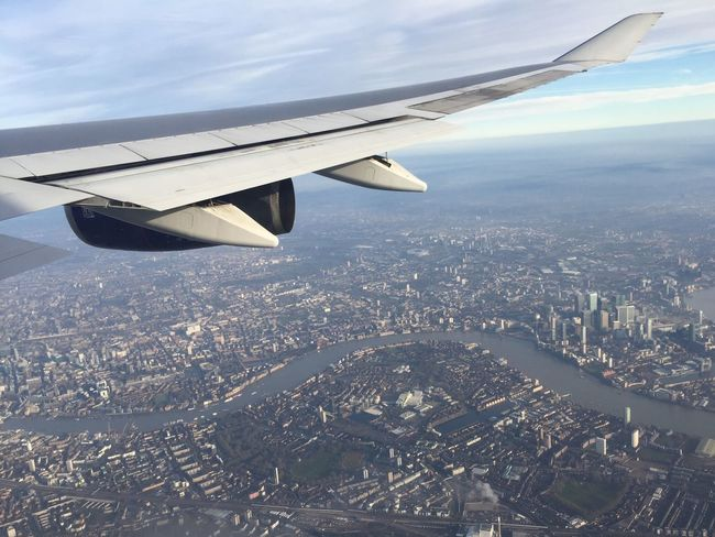 Airplane Cityscape Transportation Flying Aerial View Aircraft Wing City Mode Of Transport Cloud - Sky No People Sky Journey Outdoors Architecture Airplane Wing Landscape Air Vehicle Day London Thames
