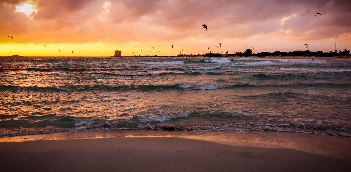 Water Sea Sky Sunset Cloud - Sky Beach Wave Land Scenics - Nature Motion Beauty In Nature Orange Color Nature Tranquil Scene Vertebrate Tranquility Horizon Over Water Aquatic Sport Surfing Outdoors