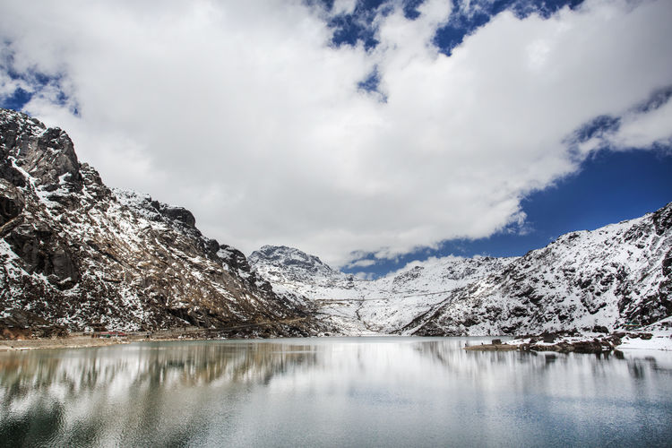 Snow mountain in Sikkim, India Beauty In Nature Cloud Cloud - Sky Cold Temperature Day Gangtok India Journey Lake Landscape Landscape_Collection Mountain Nature No People Outdoors Scenics Sikkim Sky Snow Travel Traveling Tree Water Water Reflections Waterfront