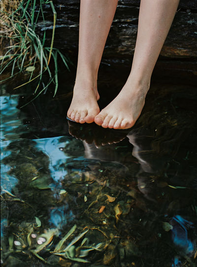 A womans feet getting ready to dip into the water. Summertime Ankle Deep In Water barefoot Body Part Feet Human Body Part Human Leg Lake Lake View Leisure Activity Lifestyles Low Section Nature One Person Outdoors Real People Summer Water Waterfront Women