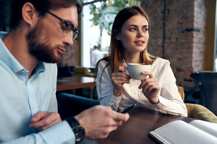 Young couple sitting on coffee