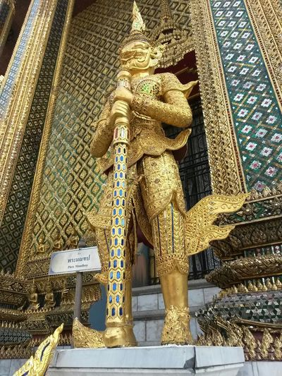 South East Asia Thailand Wat Phra Kaew Architecture Art And Craft Belief Building Building Exterior Built Structure Carving Creativity Day Gold Colored Human Representation Low Angle View No People Ornate Place Of Worship Religion Representation Sculpture Spirituality Statue Travel Destinations