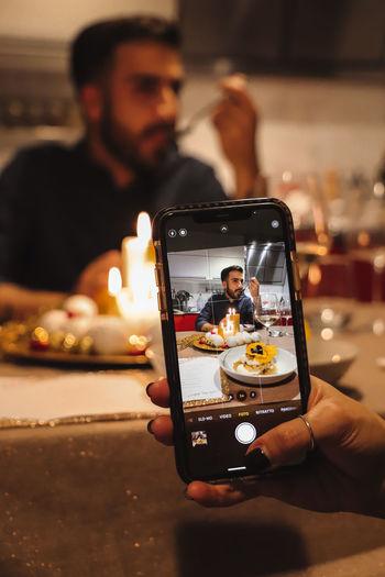 Man photographing through smart phone