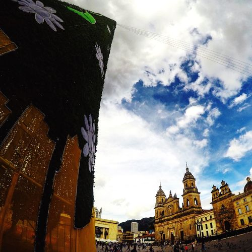 This year, I'm fortunate to be Travelling Colombia during Christmas. I'll be spending the Holidays Taking Photos of the Christmas Tree decorations and markets in Bogotá and showing you what the celebrations look like From Where I Stand .I like this photo in particular because you get a view of the plaza and the city's Architecture .
