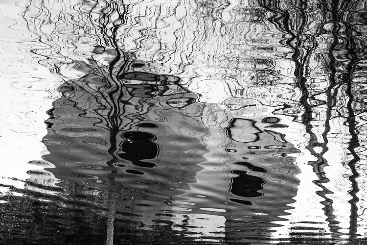 Reflection of building in puddle