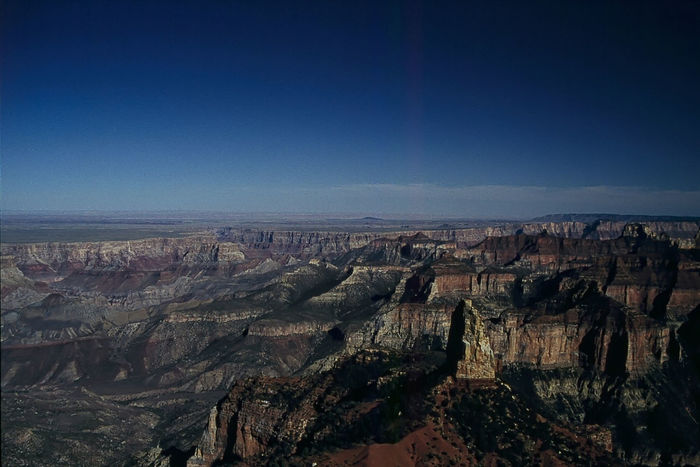 Grand Canyon: View from North Rim (1993) 1993 Analogue Photography Beauty In Nature Blue Clear Sky Day Elevated View Famous Place Horizon Horizon Over Land Majestic Mountain National Park Nature Outdoors Physical Geography Rock Formation Scenics Sky Tourism Tranquility Travel Destinations Wide Shot