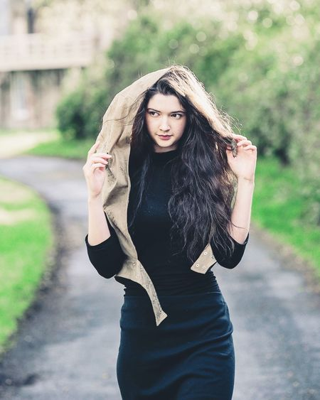 EyeEm Selects Long Hair Fashion Beautiful Woman Portrait Real People Outdoors Fashion Model Countryside Quiet Places Quiet Road Stroll Dark Hair Trees Looking Away Tall Scotland 💕 Betty Spoke Clothing Canonphotography Lifestyles Young Women Hood Shelter One Person Beauty
