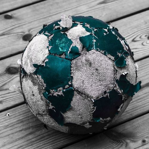 Wood - Material Close-up Table No People High Angle View Still Life Day Pattern Outdoors Nature Focus On Foreground Art And Craft Blue Wood Decoration Shape Design Green Color Creativity Turquoise Colored Football Ball