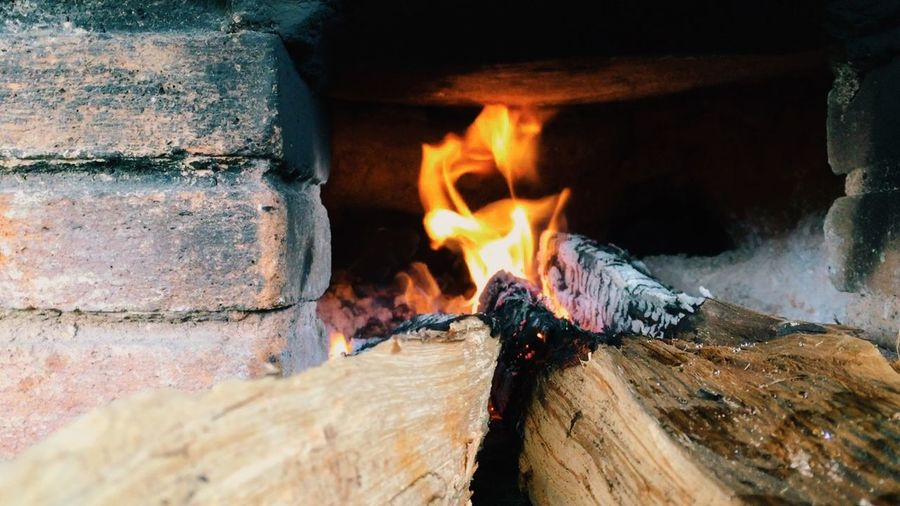 Close-Up Of Firewood Burning In Fireplace