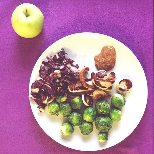 High Angle View Of Radicchio With Brussels Sprouts And Mushroom Served On Table