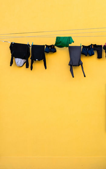 High angle view of clothes drying against yellow wall