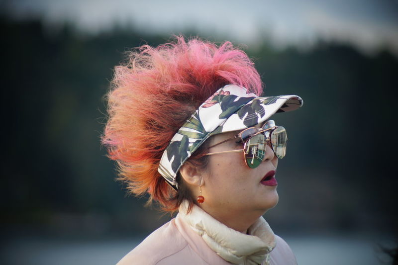 Close-up of mature woman wearing sunglasses