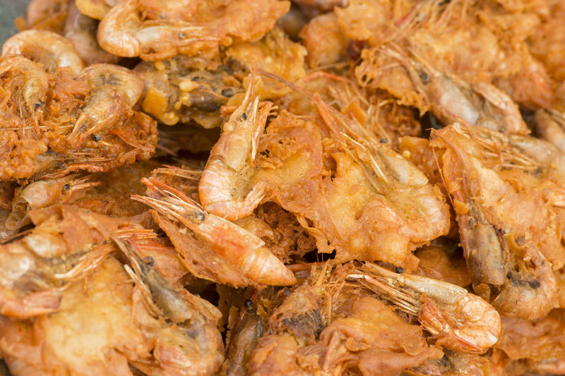 Close-up of fried prawns for sale in market