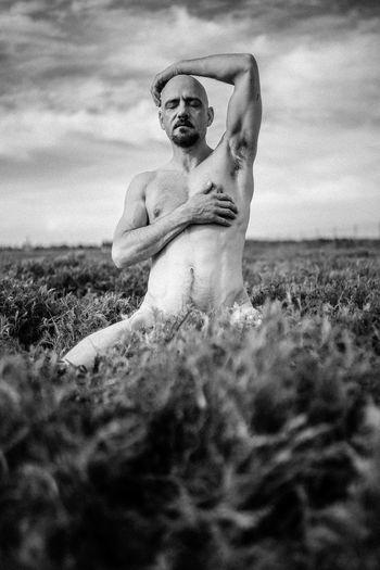 Statue of man on field