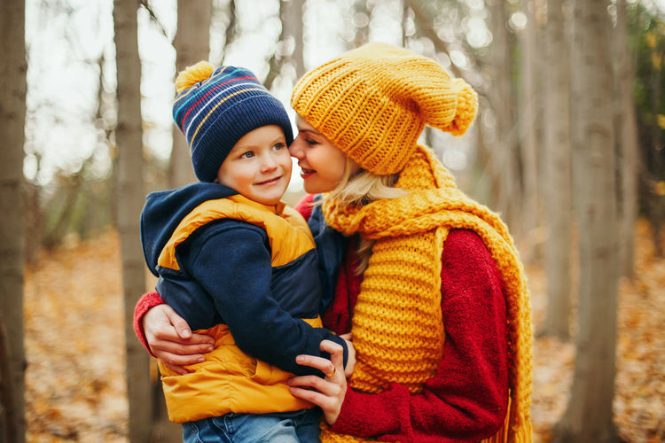Mother and son in park during autumn