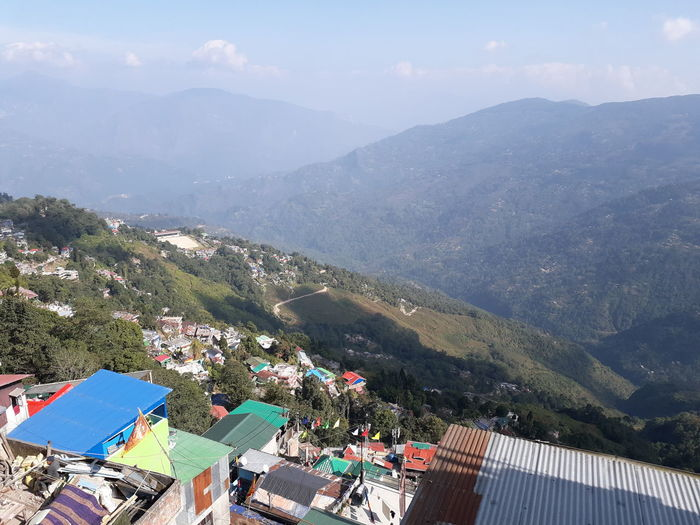 High angle view of buildings and mountains against sky