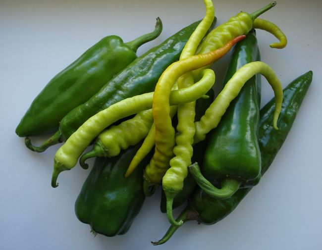 High angle view of green chili peppers